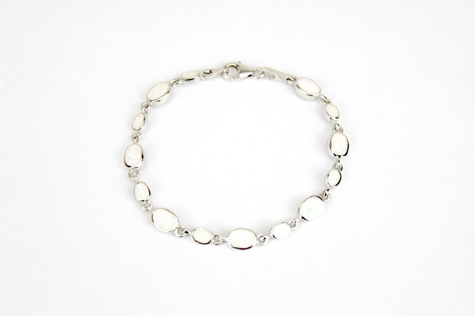 White Opal Fire silver set claw clasp Bracelet 14 created stones medium and small oval