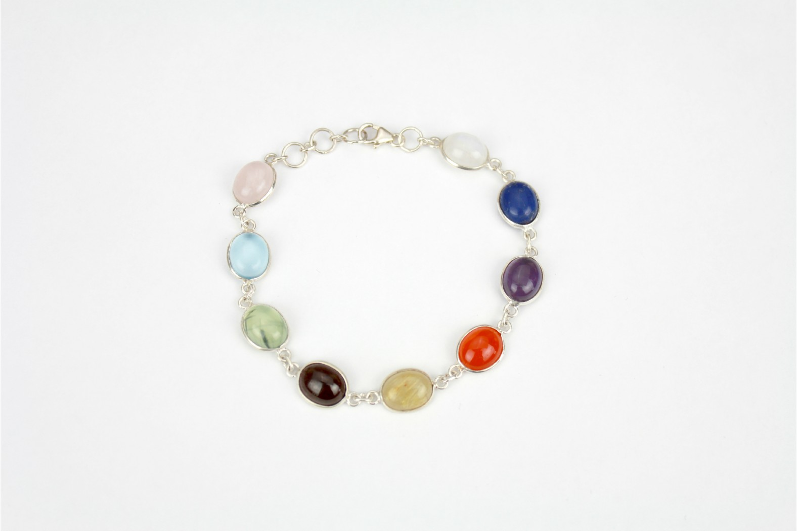 Nine oval shaped multi colour silver set with claw fastener.
