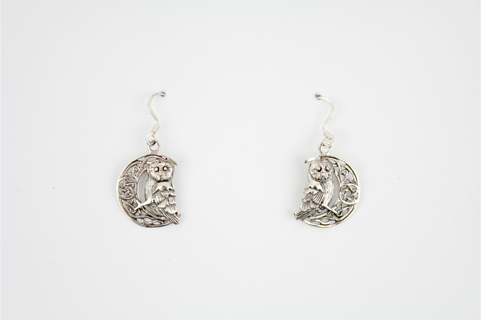 Owl on the moon style drop earrings mounted on silver detailing