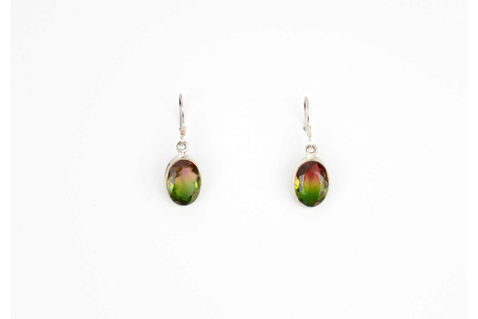 Oval shape autumnal shades faceted Mystic Topaz silver set detailing