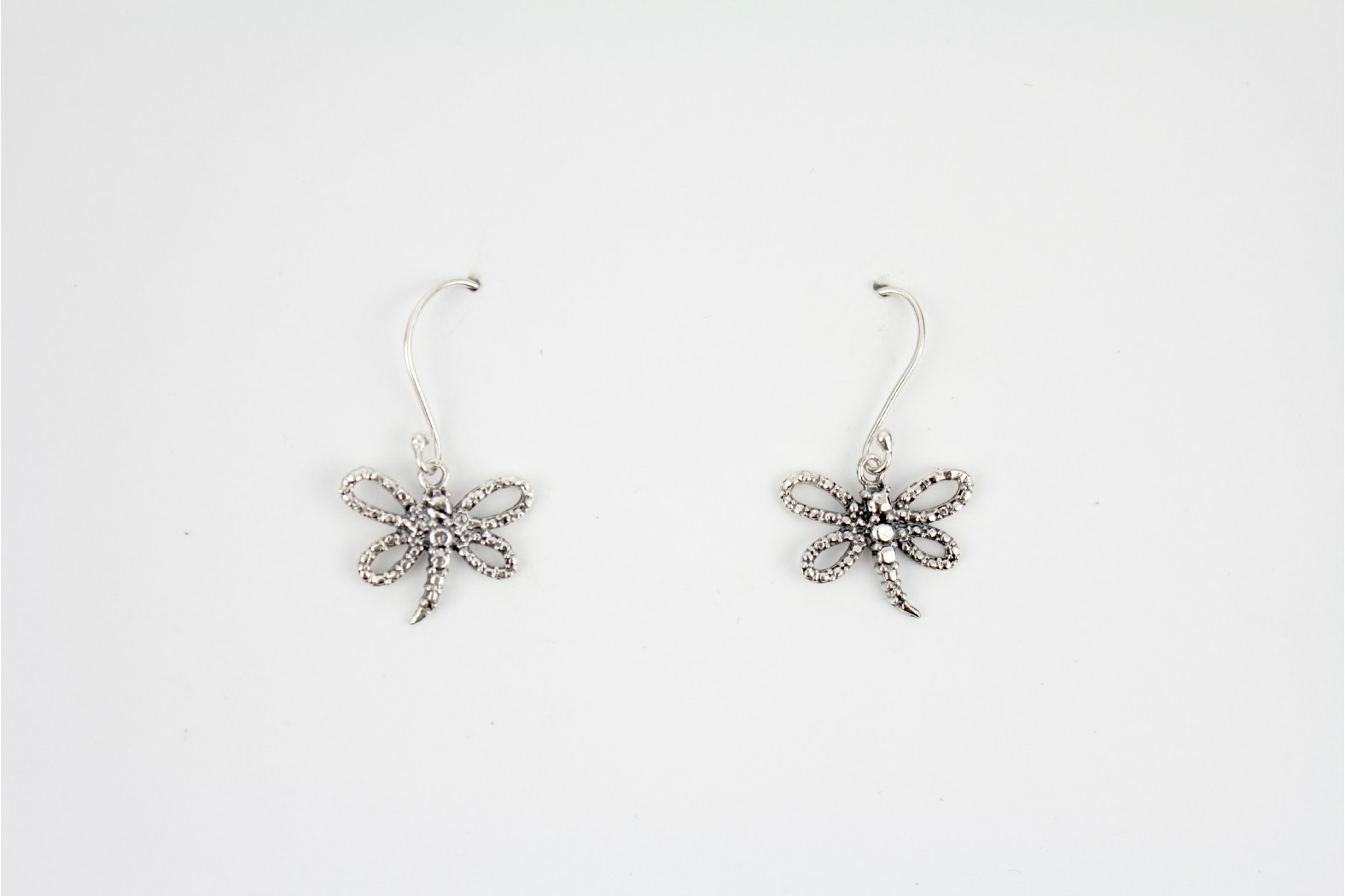 Fine detailing Dragon Fly style aged silver design