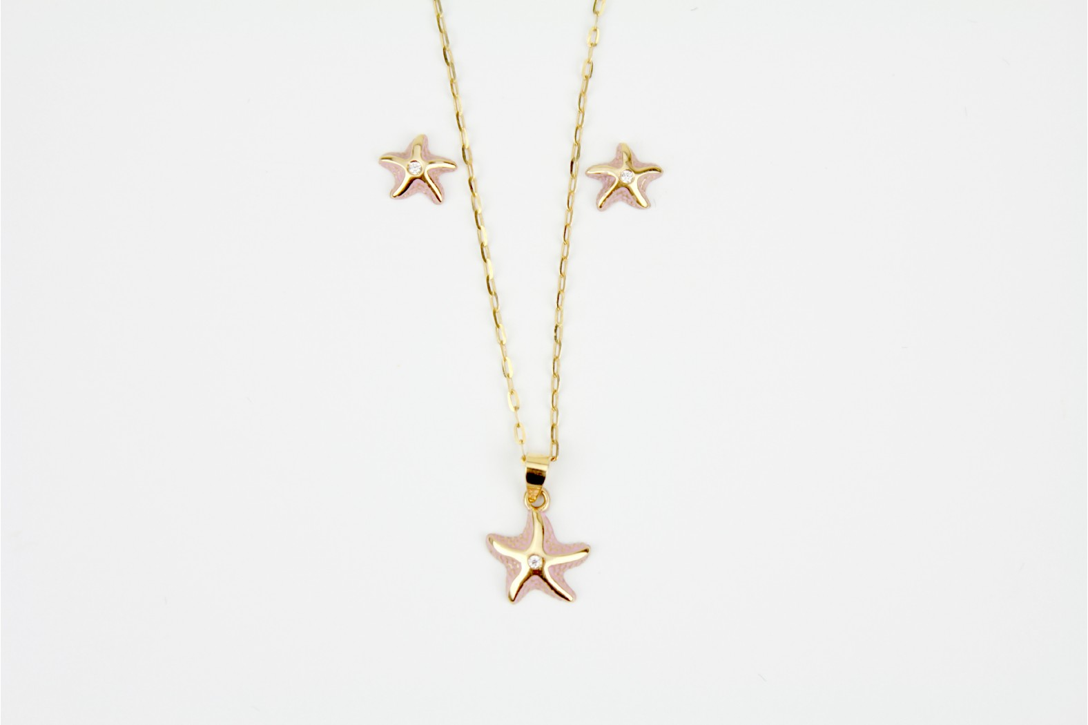 Starfish design pendant with complementary stud earrings having central diamond elements on matching 18inch or 45cm chain.