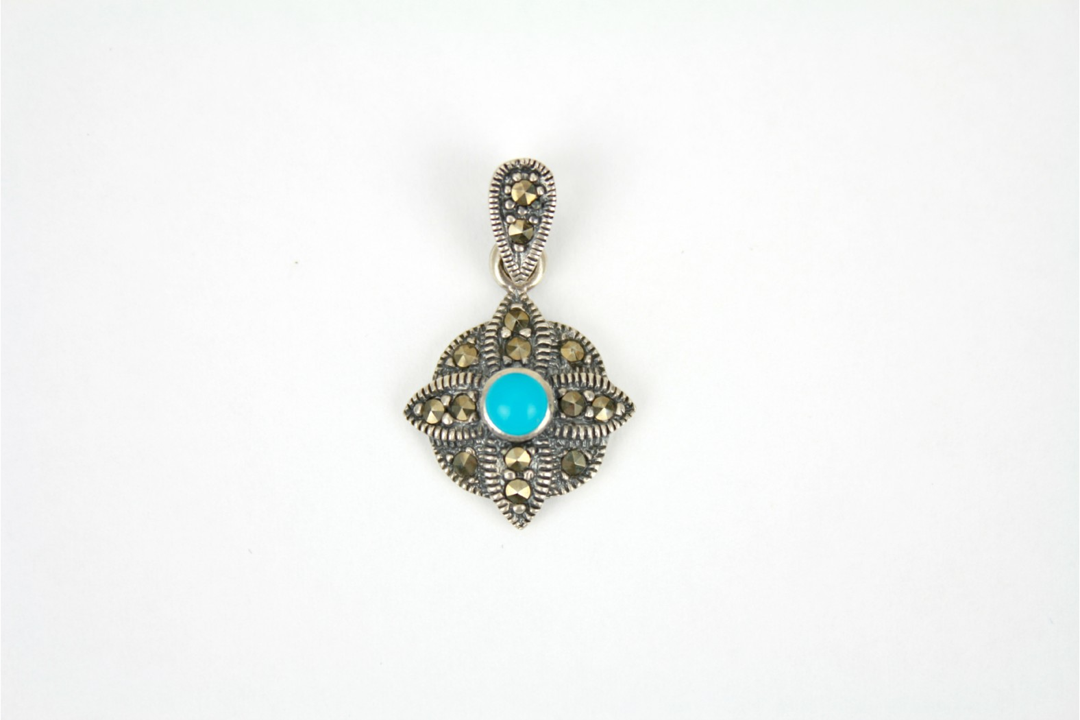 Petite Flower shaped with centrepiece Turquoise stone embellished with Marcasite stones