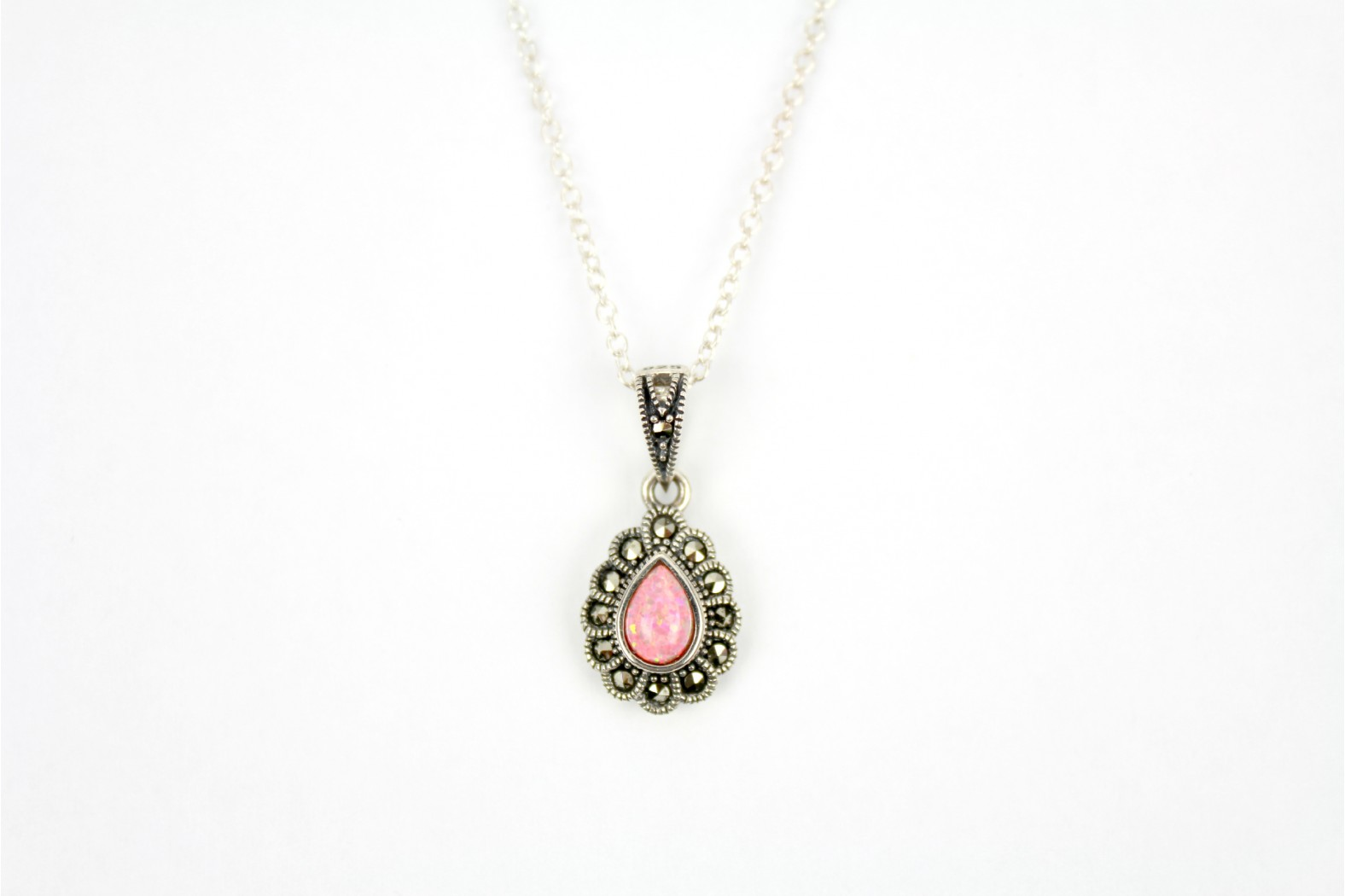 Beautiful Coral Pink Opal Fire teardrop shape surrounded with Marcasite stones  With 18inch 45cm link style chain