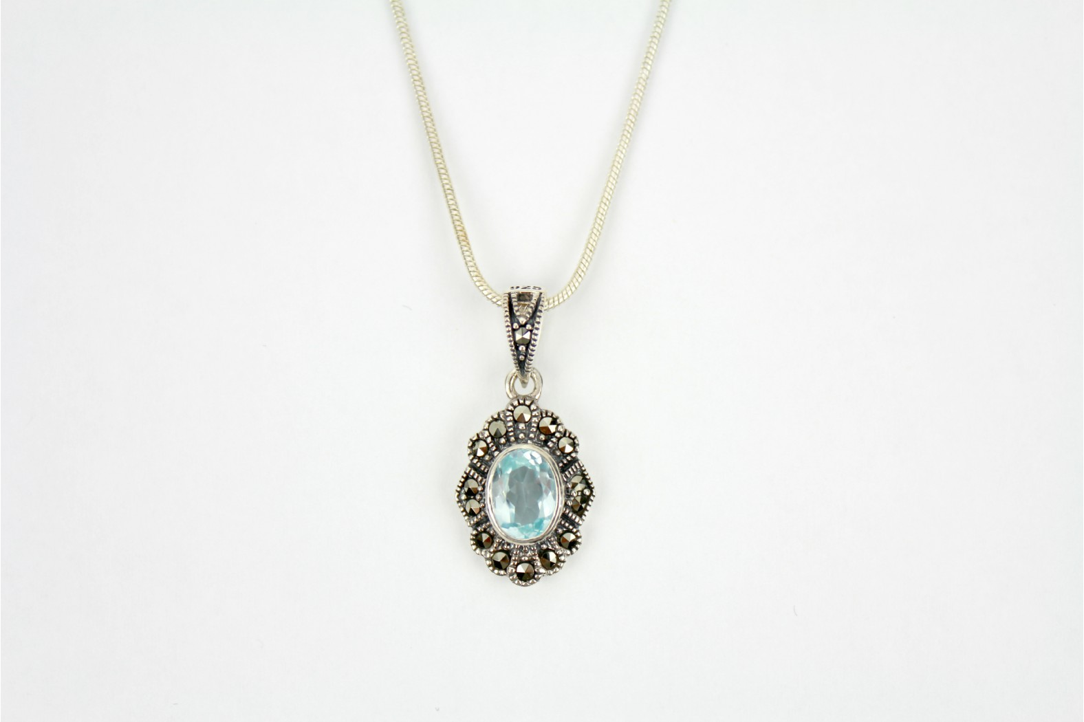 Delightful oval shaped faceted Blue Topaz stone surrounded with Marcasite stones  With 18inch 45cm snake chain