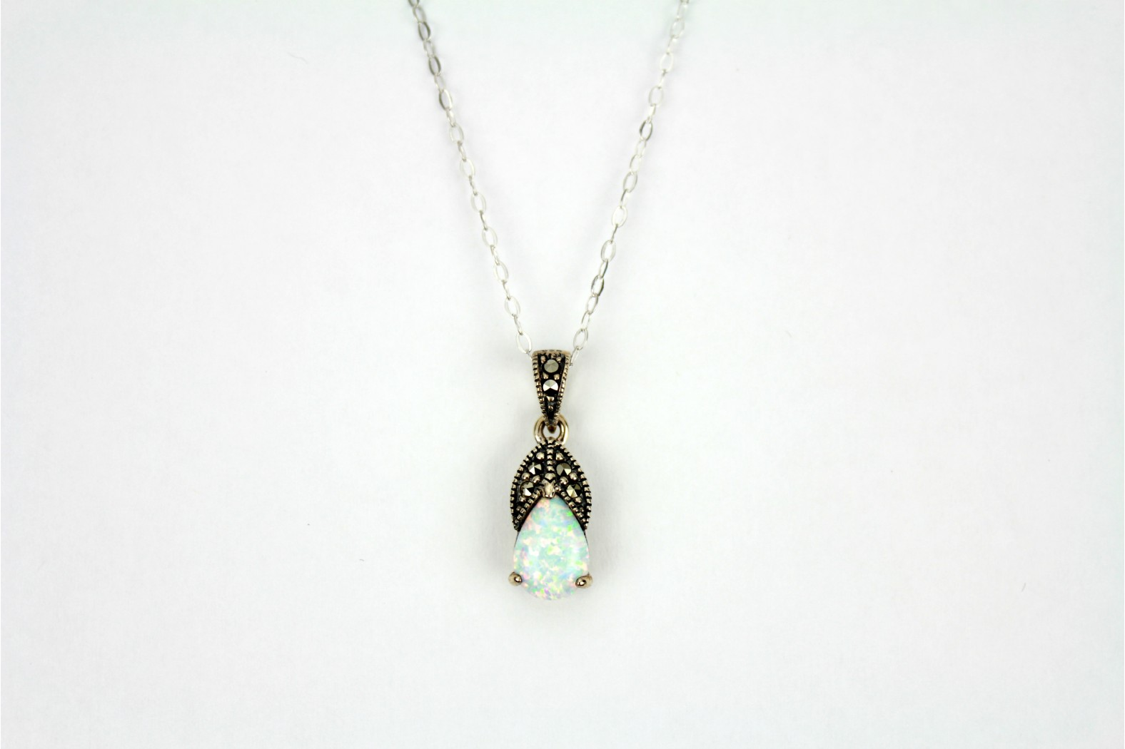 Gorgeous Teardrop shaped White Opal Fire with claw set and Marcasite petals.. With 18inch  45cm cable link style chain