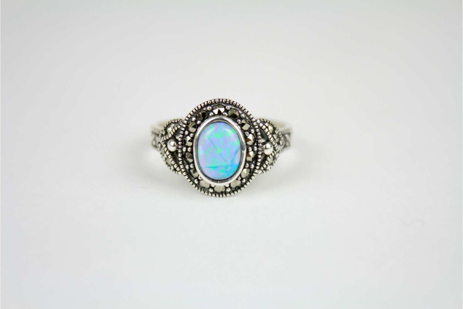 Contemporary set oval shaped Blue Opal Fire with  Marcasite surrounds and shoulders. Size 10 or T