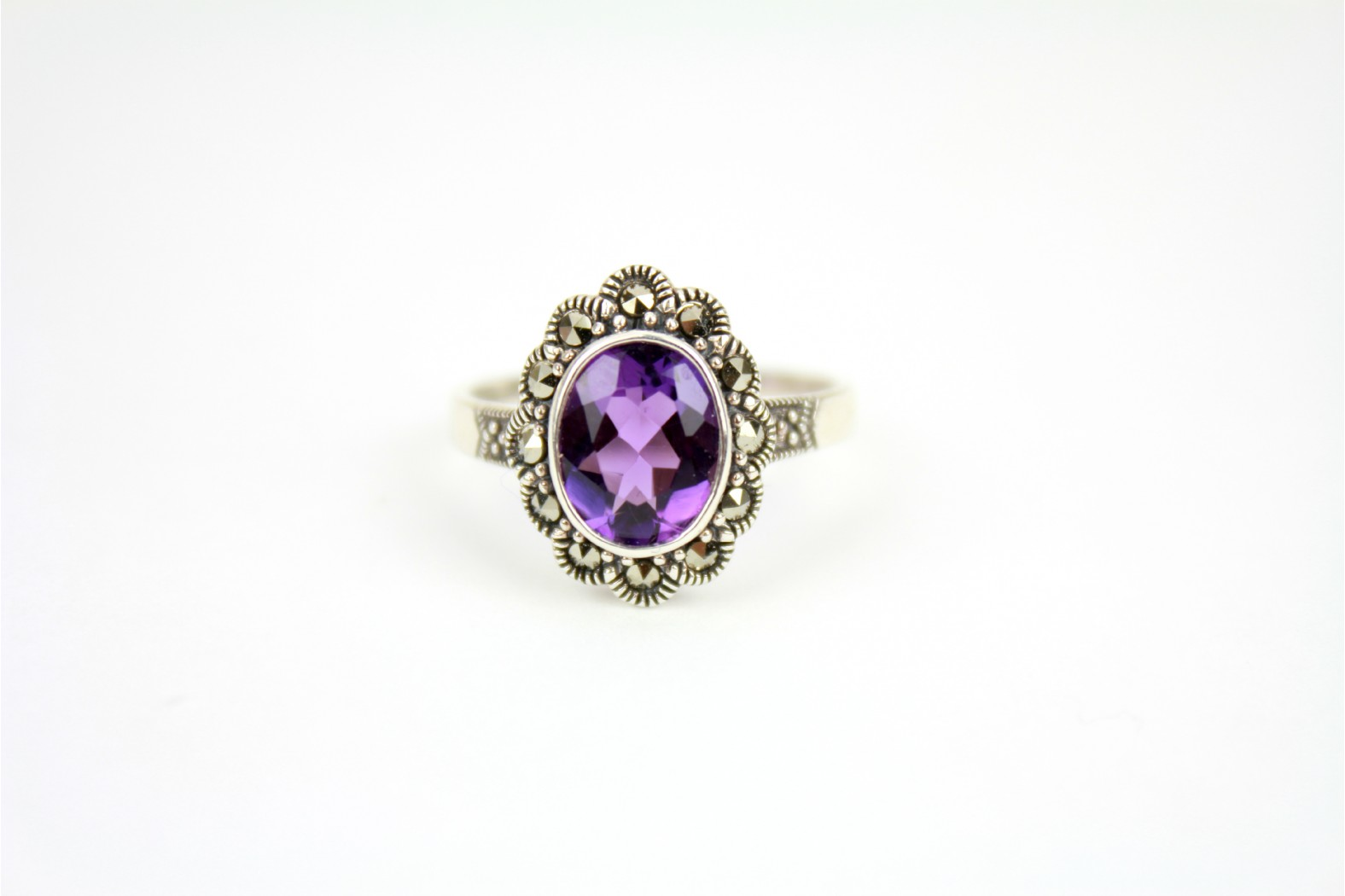 Beautiful oval shaped faceted Amethyst surrounded with Marcasite stones size 9 or R