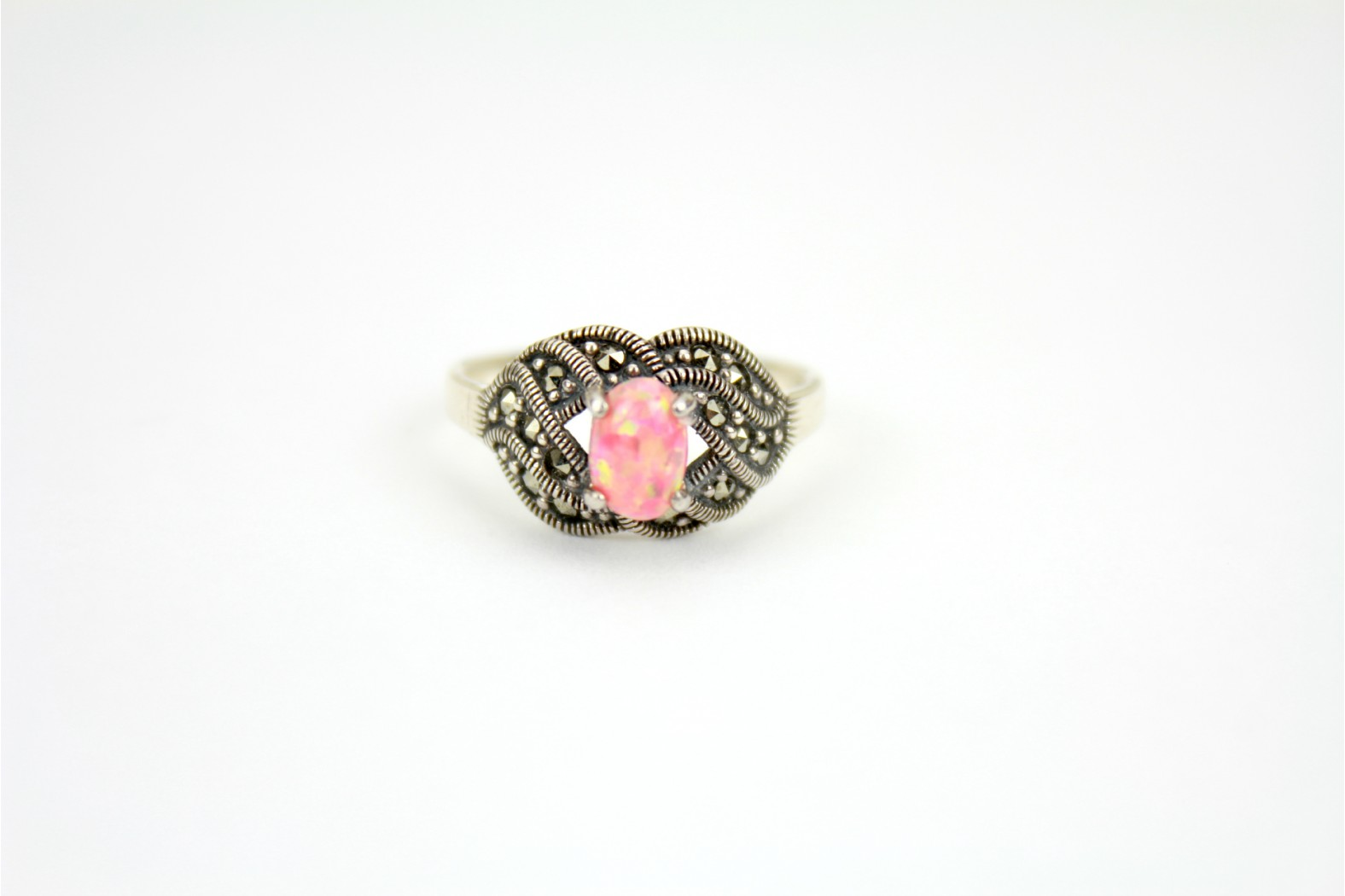 Coral Pink Opal Fire set on raised Marcasite stone shoulders size 8 or P