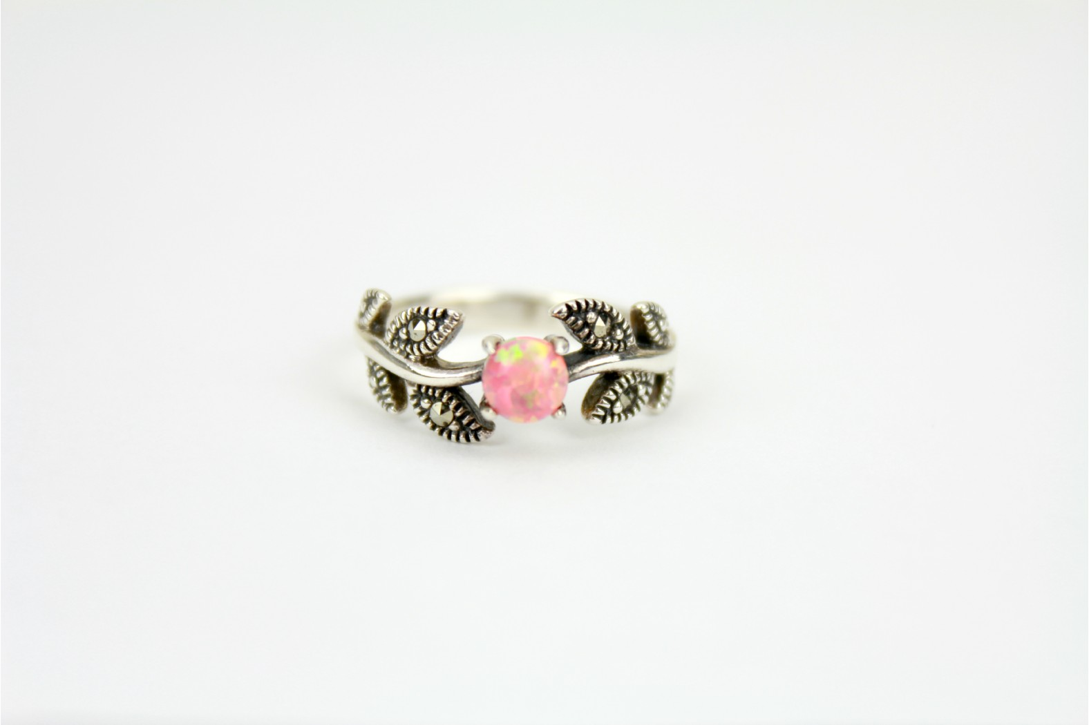 Stunning creation Coral Pink Opal Fire with Marcasite stones set on vine leaf style detailing size 7 or N