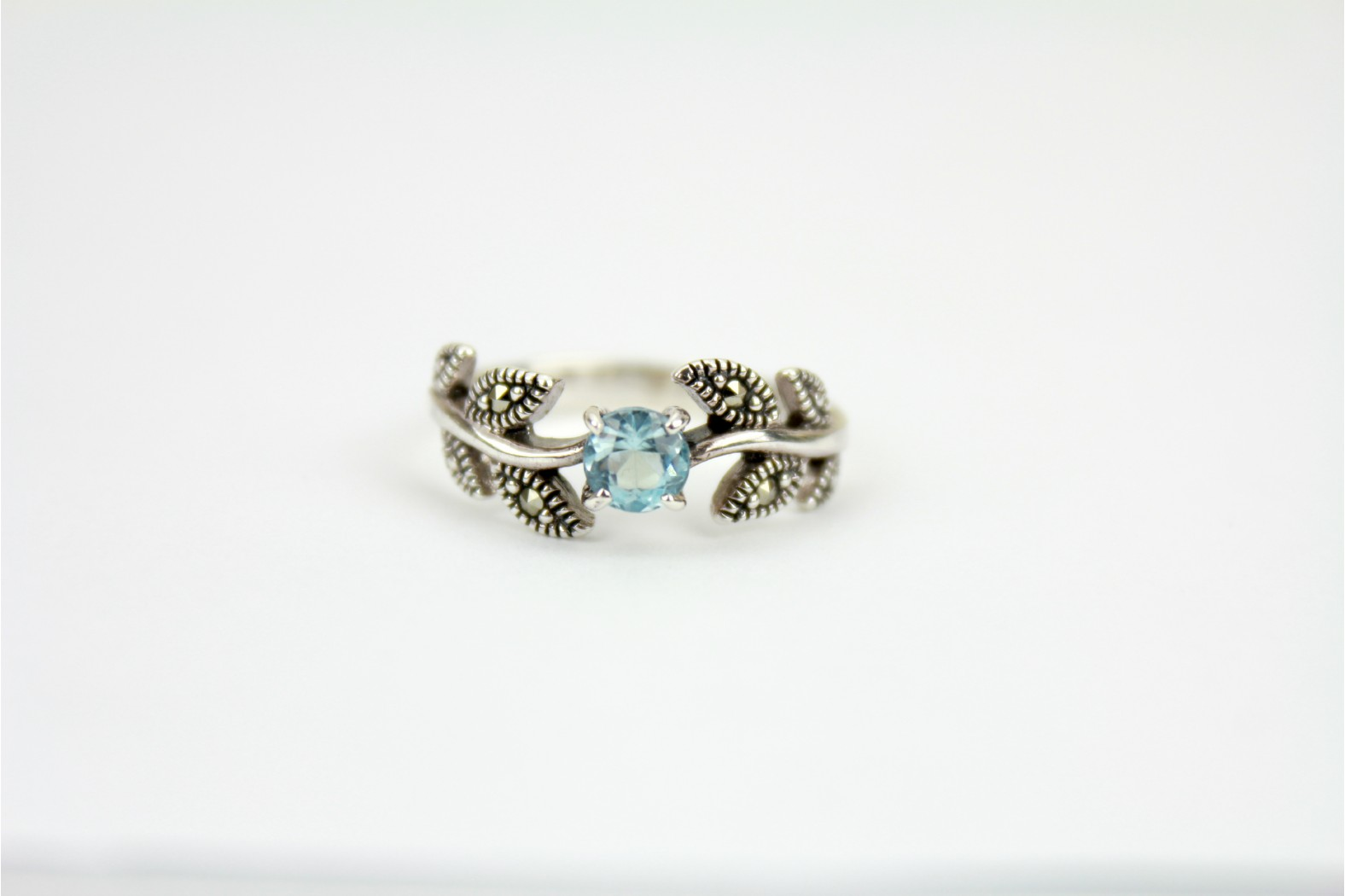 Stunning creation Blue Topaz with Marcasite stones set on vine leaf style detailing. Size 8 or P