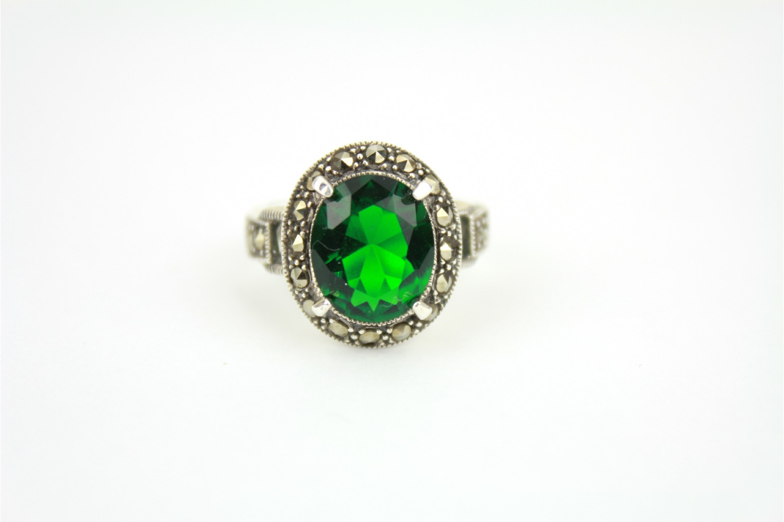 Chunky style oval shaped faceted Emerald colour surrounded with Marcasite stones. Size 7 or N