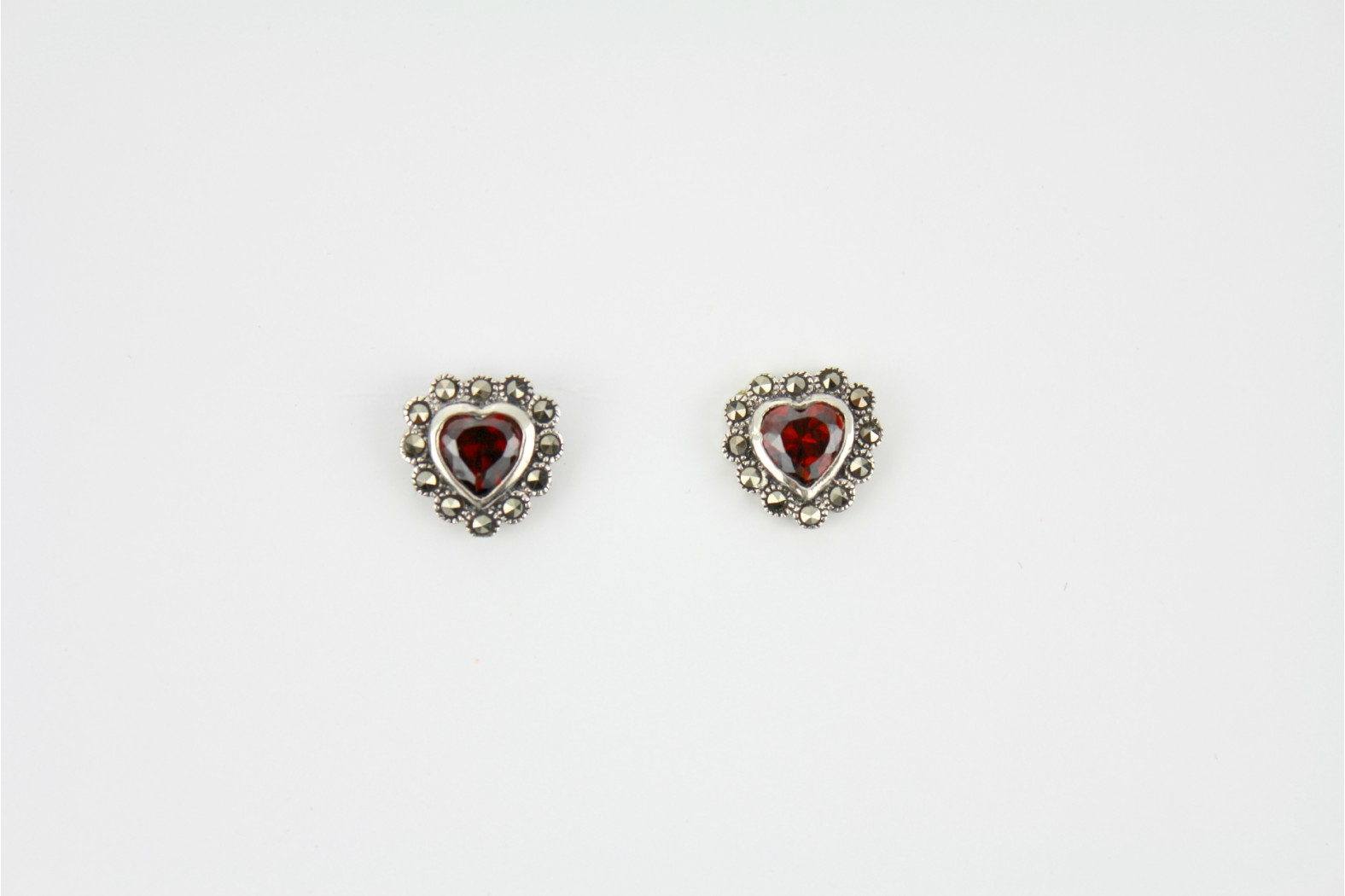Garnet colour heart studs surrounded with Marcasite stones. DELIVERY 10 WORKING DAYS