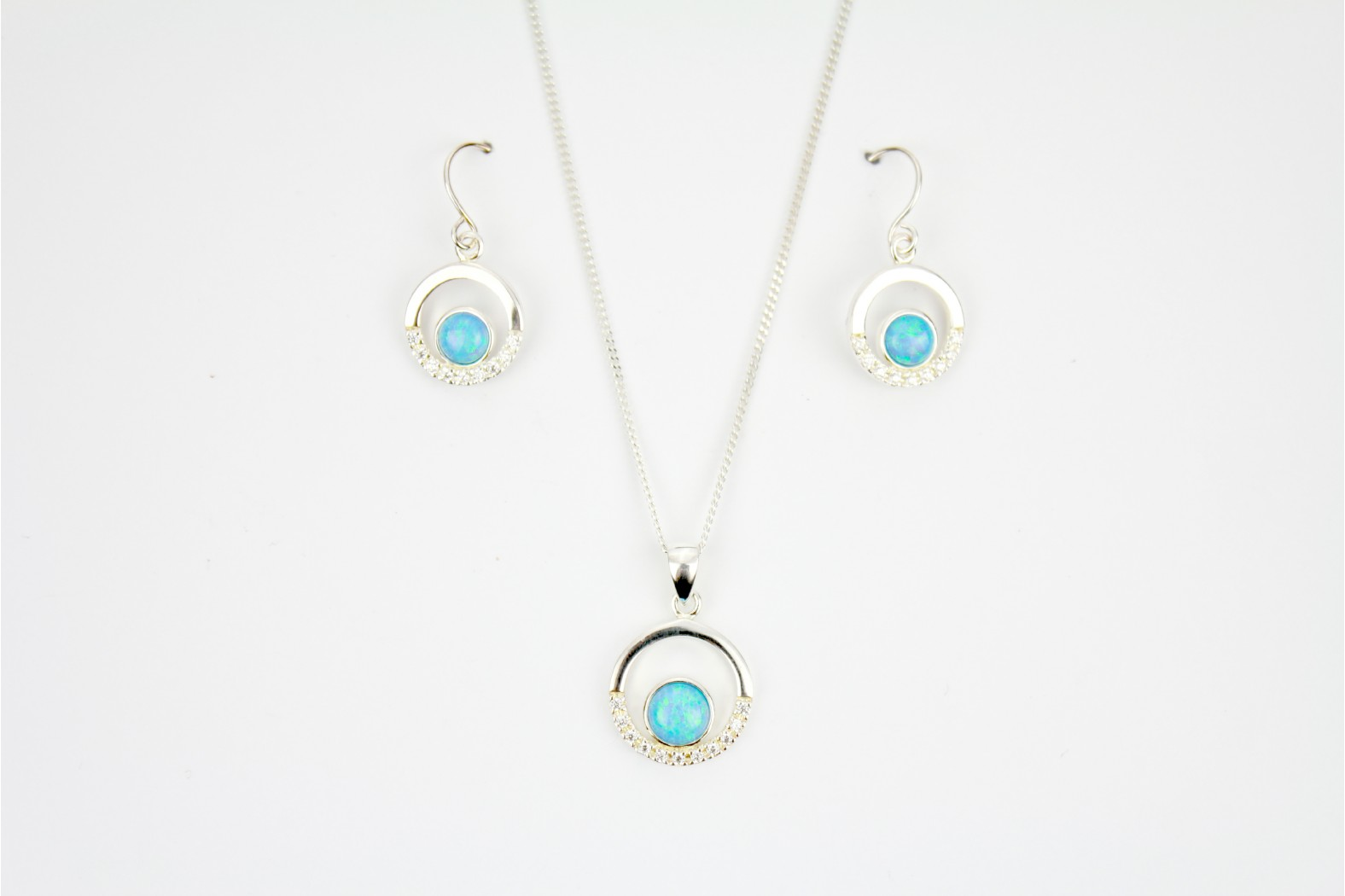 Beautiful Blue Opal Fire with cubic zirconia enhancements mounted within circular shapes complimentary short drop earrings on 18inch 45cm. cable chain.