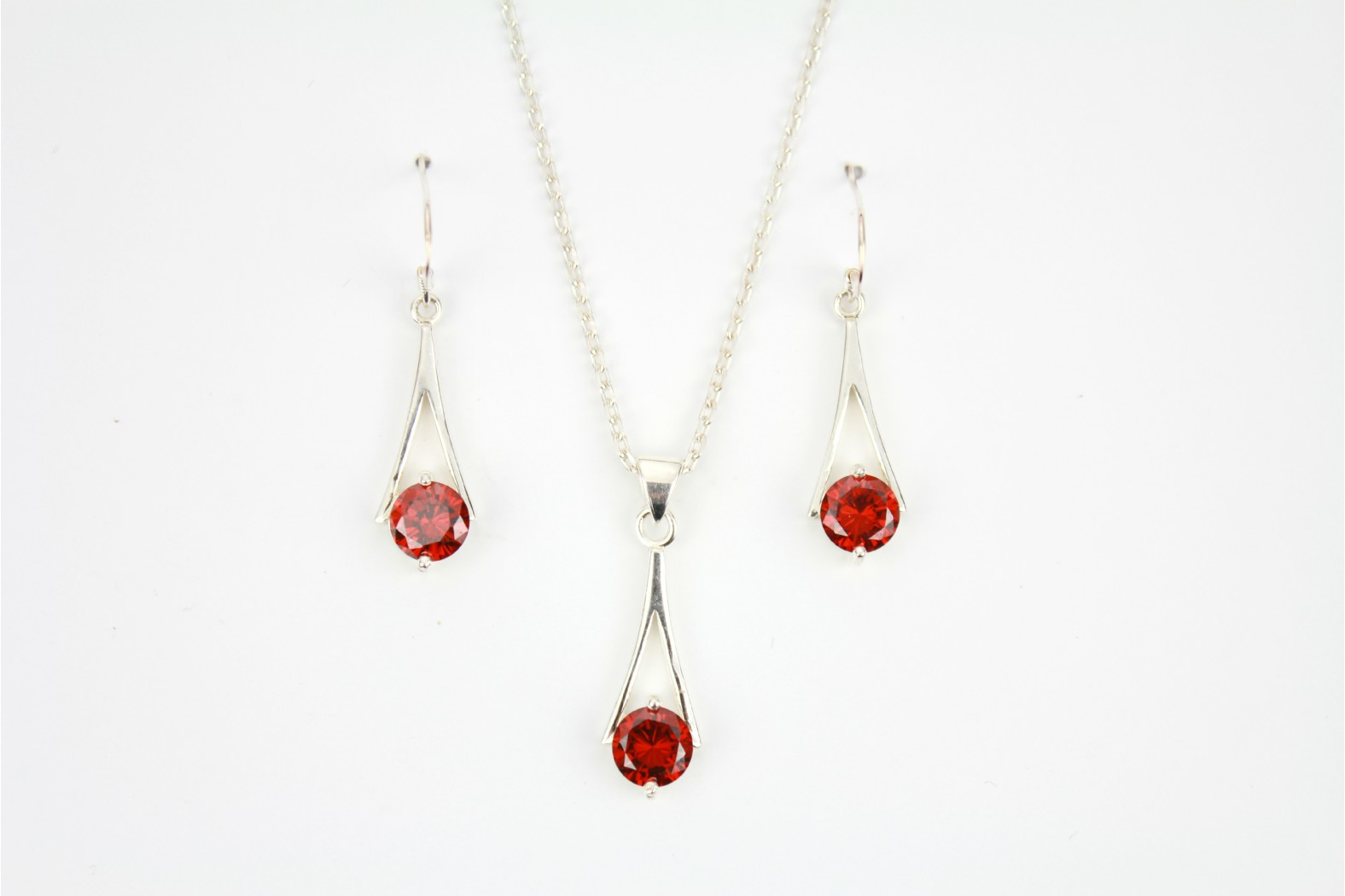 Contemporary style Garnet set mounted on silver detailing complementary drop earrings on 20inch 50cm heavy cable style chain.  TEMPORARILY OUT OF STOCK
