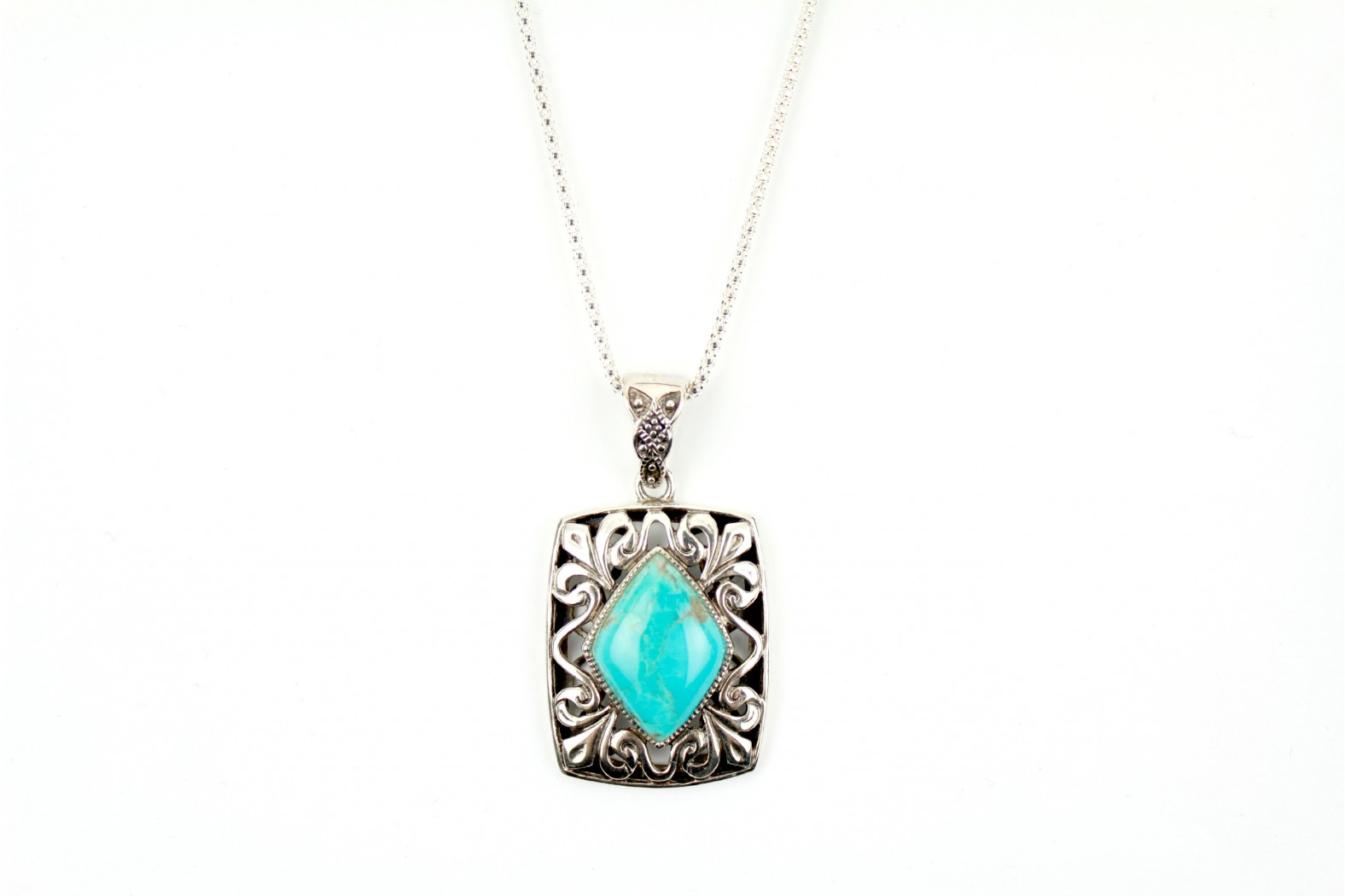 Turquoise Stone set in heavy detailed silver with 20 ins. 50cm heavy Popcorn chain.