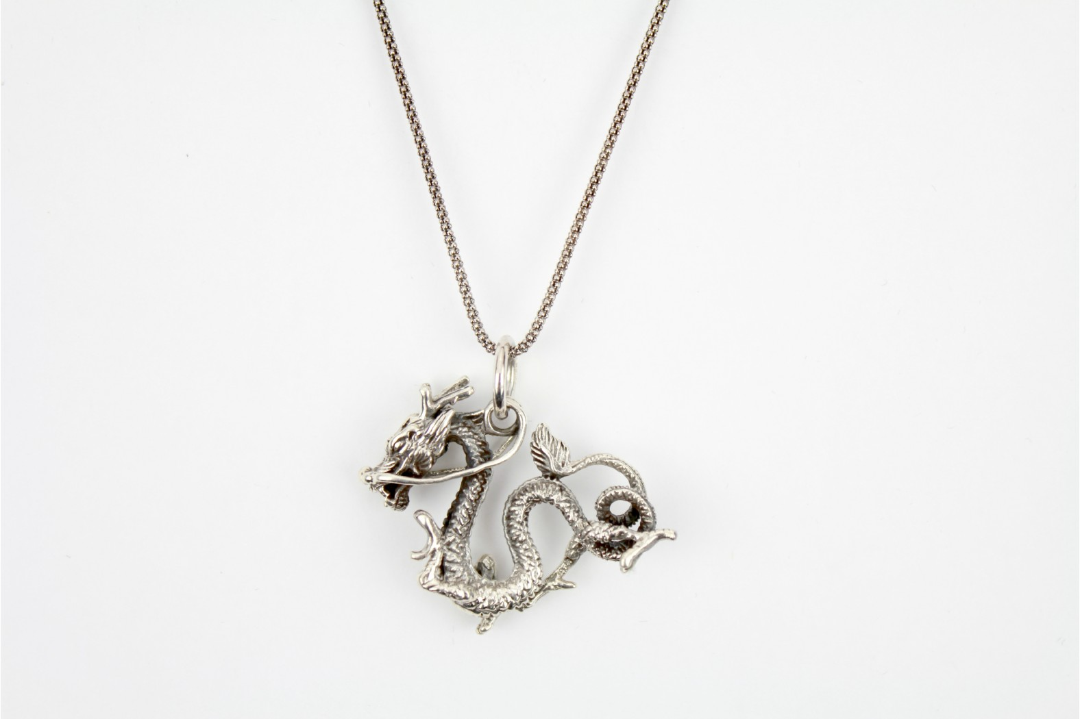 Stunning 3D design Celtic Dragon aged silver on 22/24 ins 55/60cm chain which has undergone accelerated oxidation to ensure design match