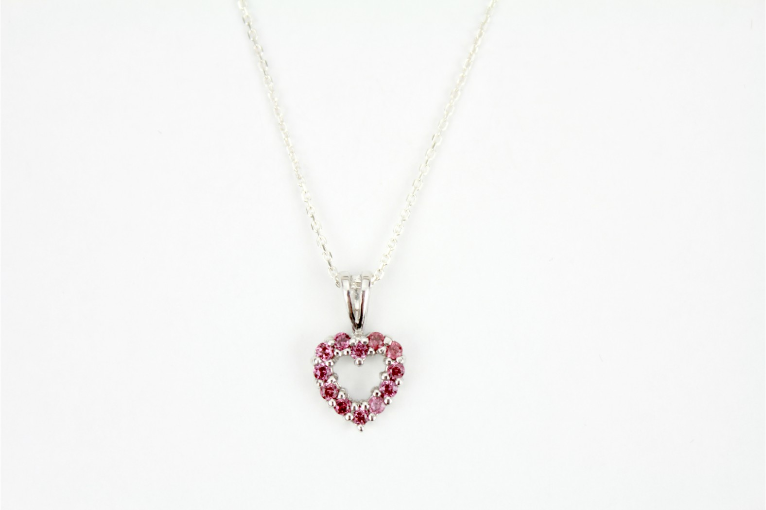 Delightful fuchsia pink cubic zirconia stone heart with silver claw set detailing on 18ins    45cm cable chain