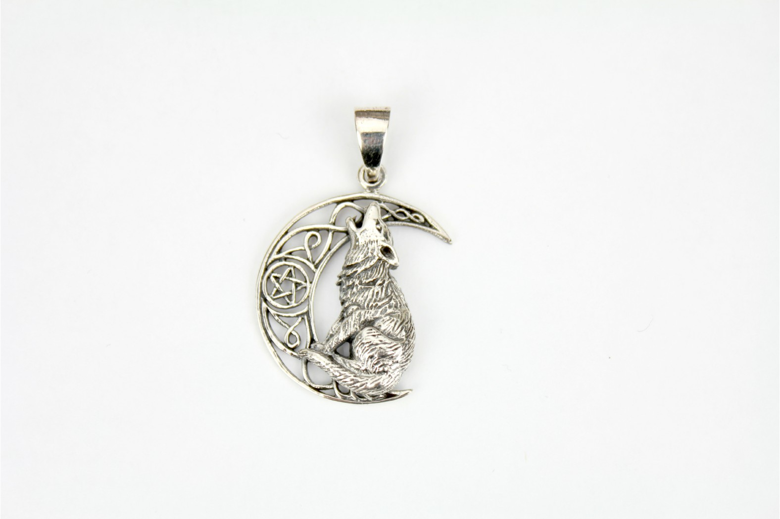 Wolf on moon style set on silver detailing.