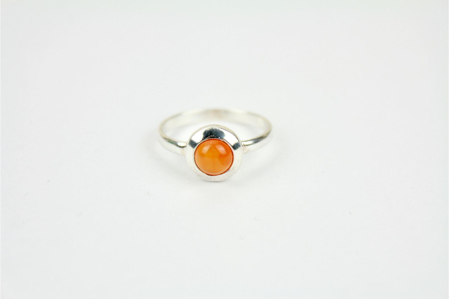 Contemporary circular Amber colour mounted in silver size 7 or N