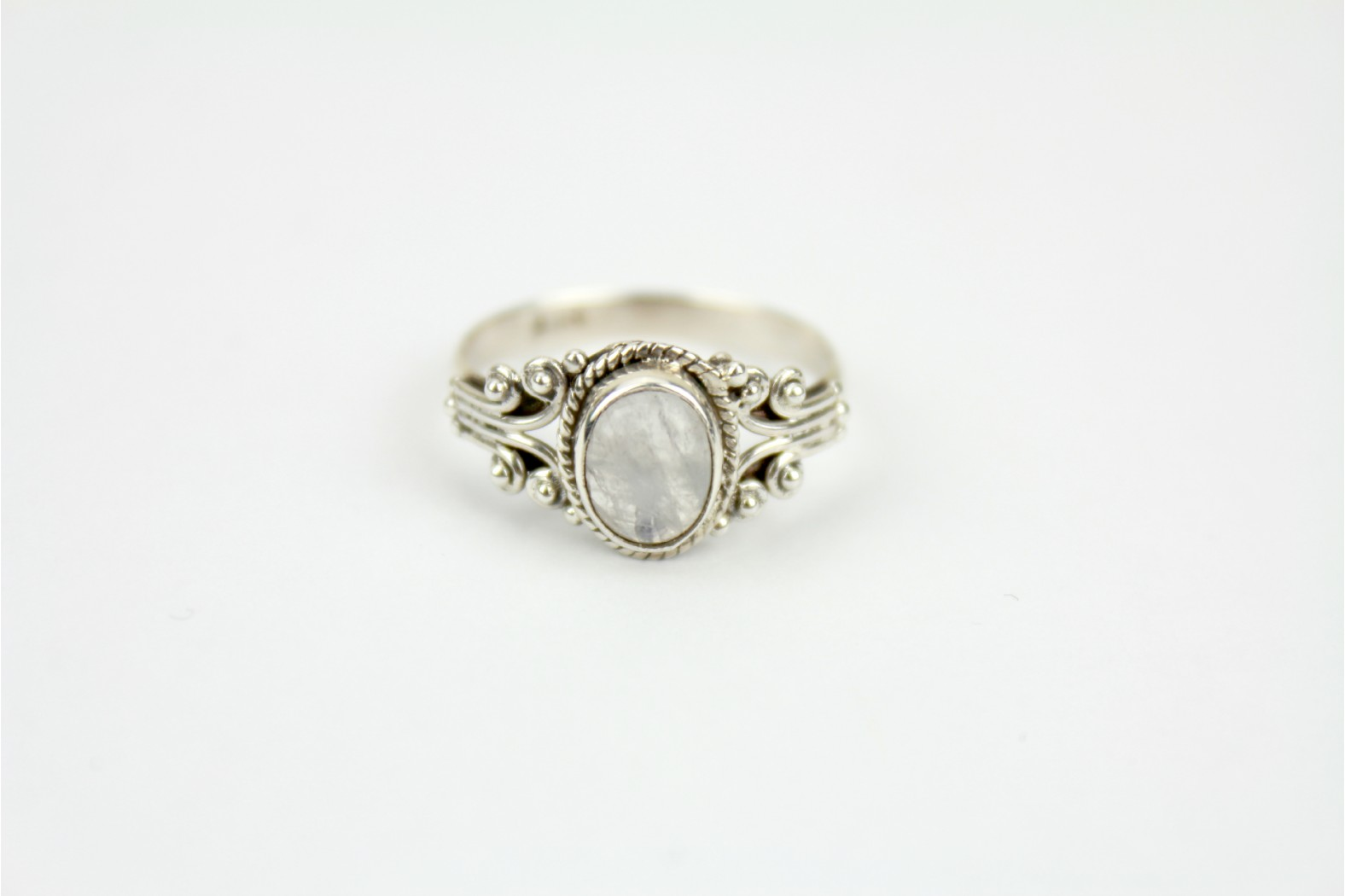 Oval Rainbow Moonstone with filigree shoulder design size 8 or P