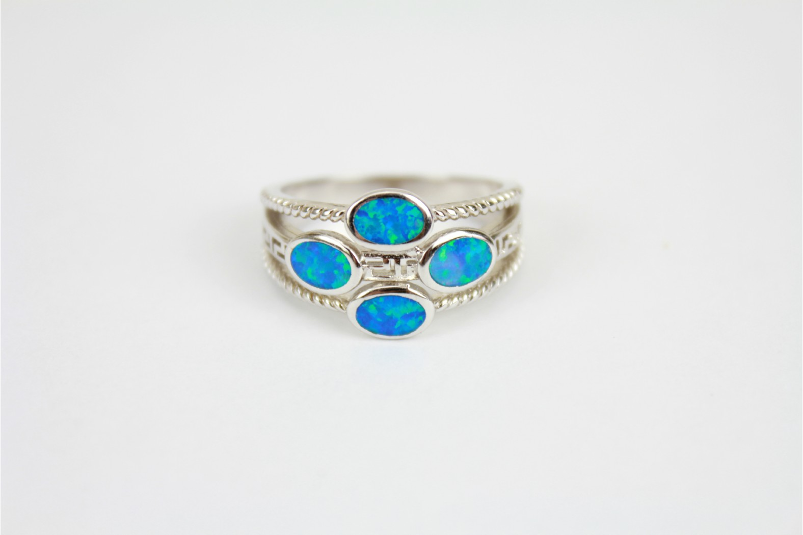 Blue Opal Fire with Greek design cut out size 9 or R