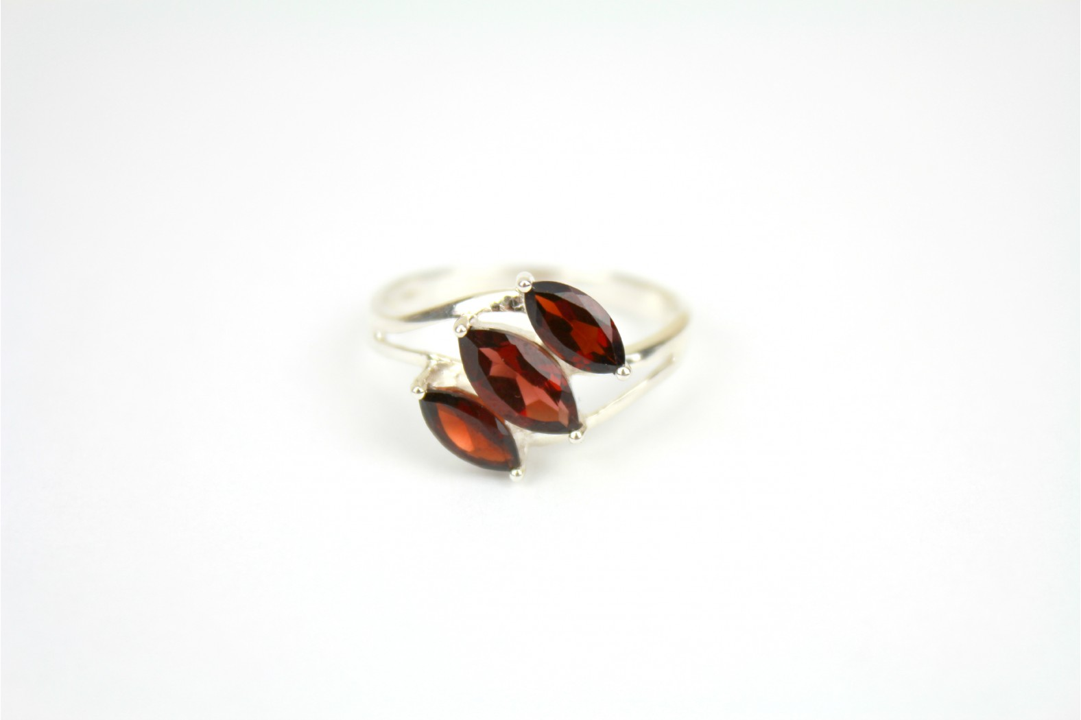Three faceted Garnet diametrically set on silver size 10 or T. DELIVERY 10 WORKING DAYS
