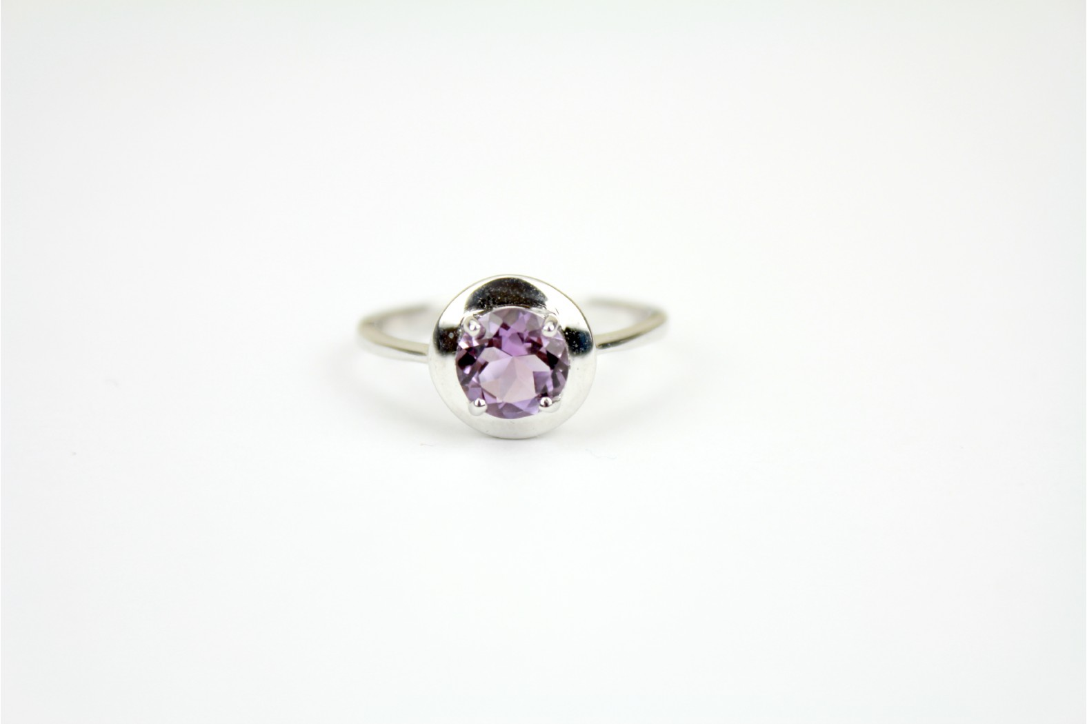 Faceted Amethyst claw set contemporary design on silver size 8 or P