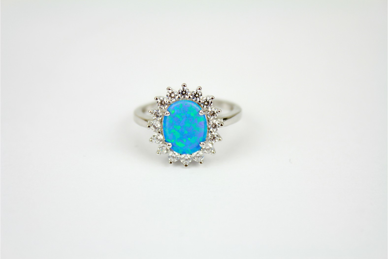Oval5 Blue Opal fire embellished with clear cubic zirconia sizes 7 or N and 8 or P