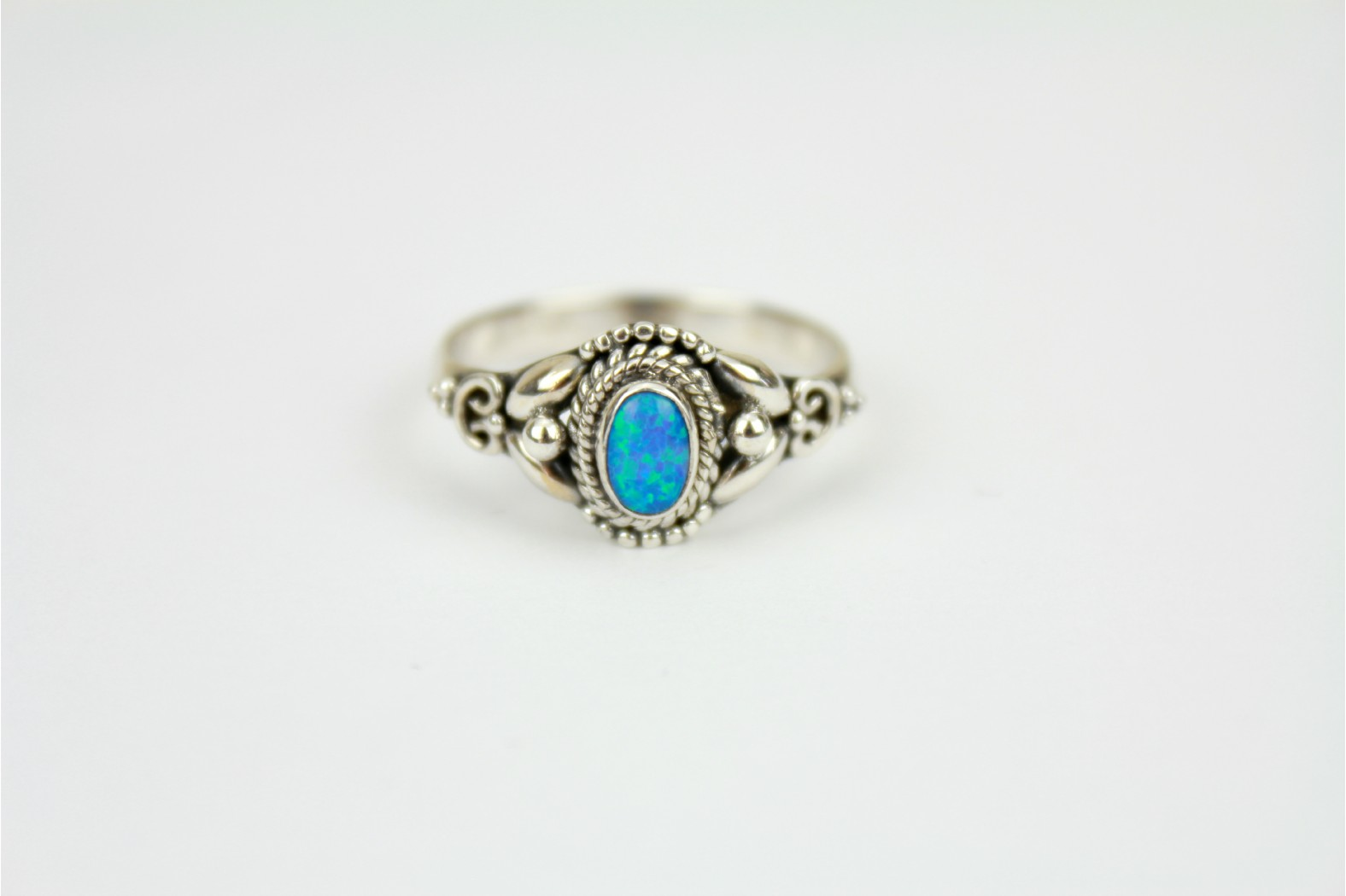 Oval Blue Opal fire set on silver with shoulder detailing size 9 or R