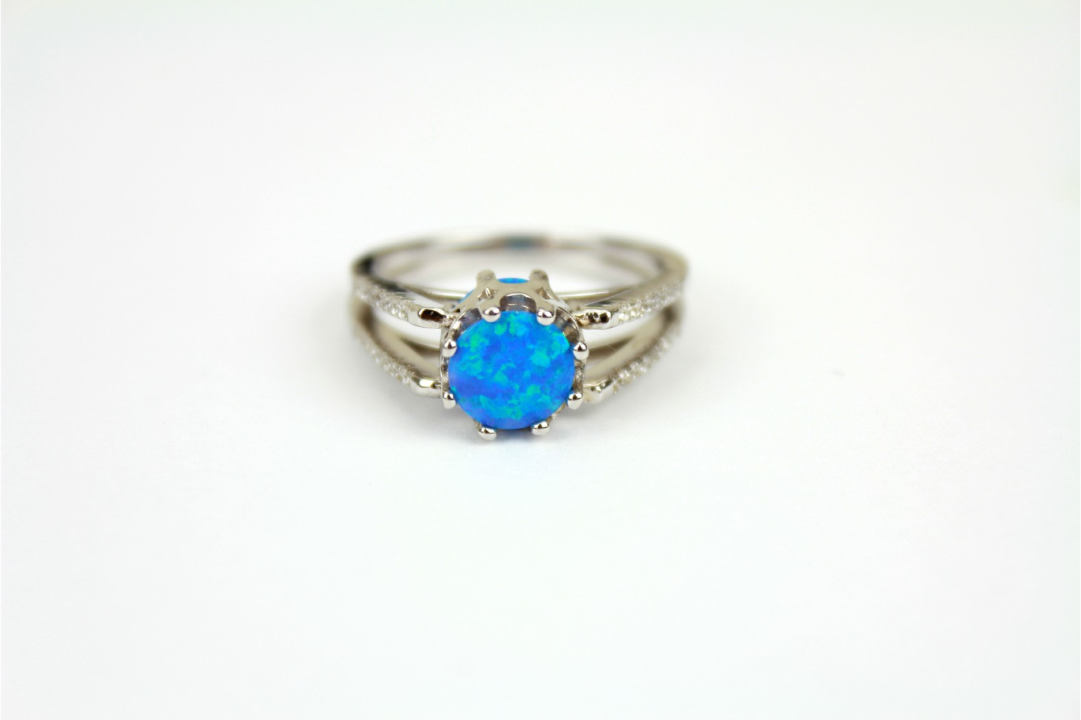 Round Blue Opal fire law set modern design cubic zirconia on shoulders size 9 or R