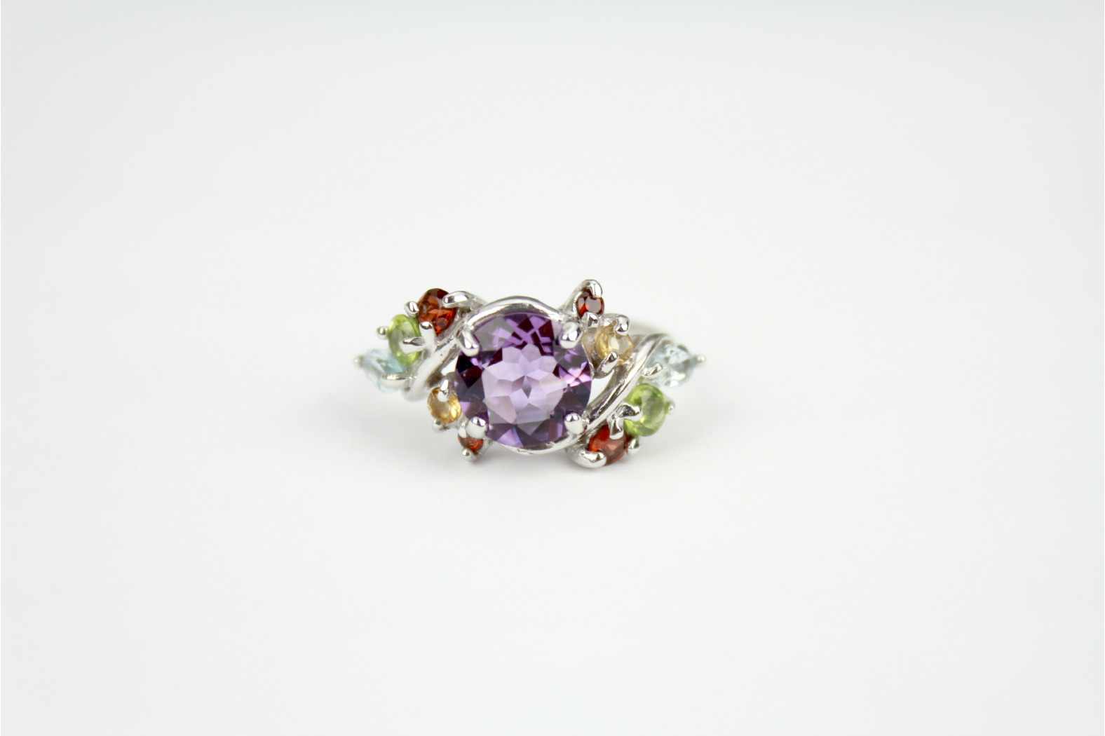 Beautiful Amethyst with multi colour stone detailing set on ornate silver shoulders size 8 or P