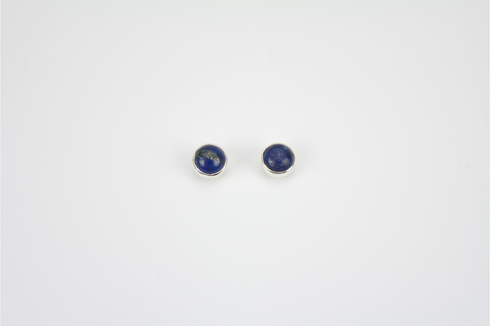 Circular Lapis stud earrings encased in silver mounting