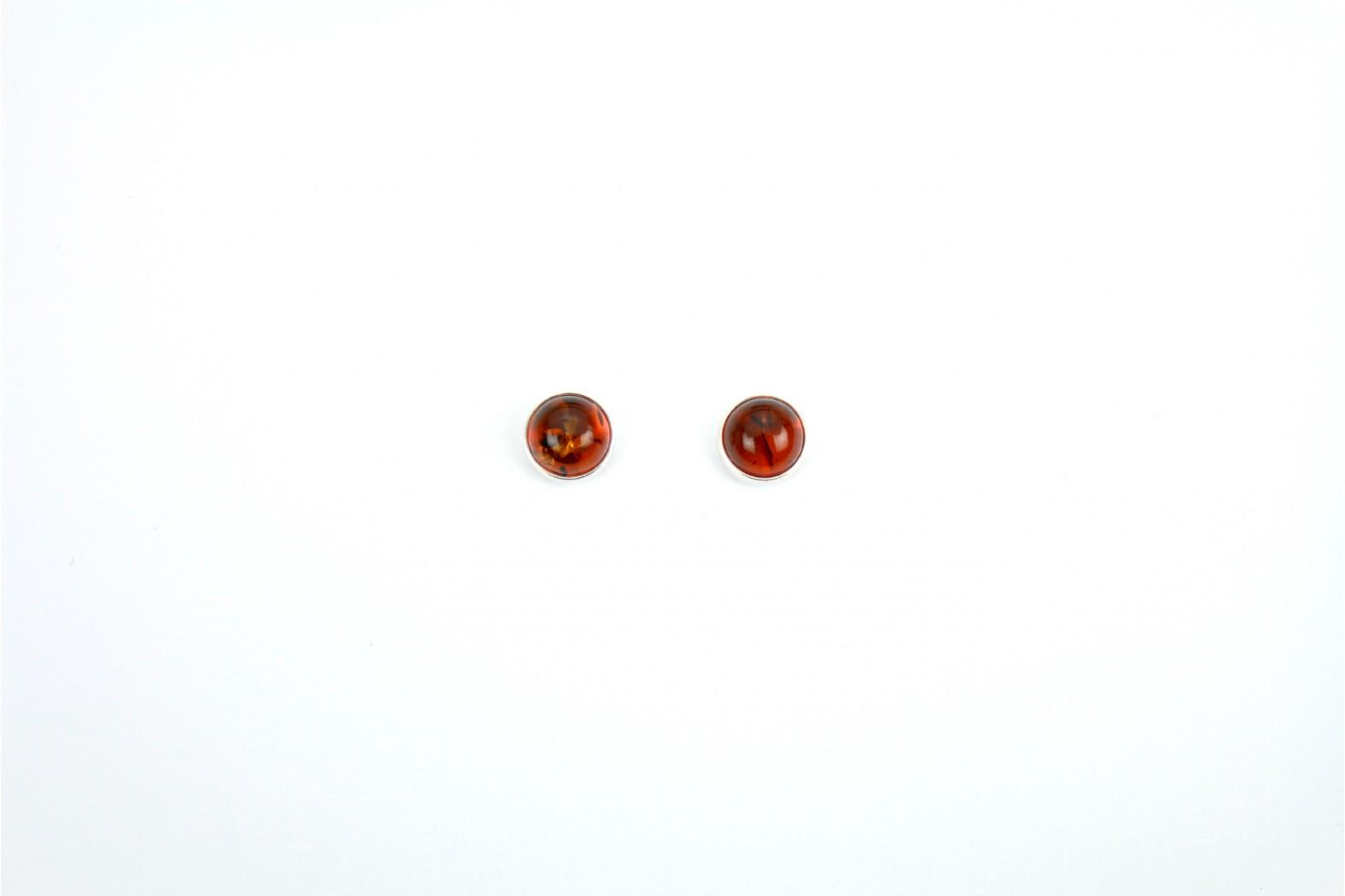 Circular Amber stud earrings set in circular silver mounting