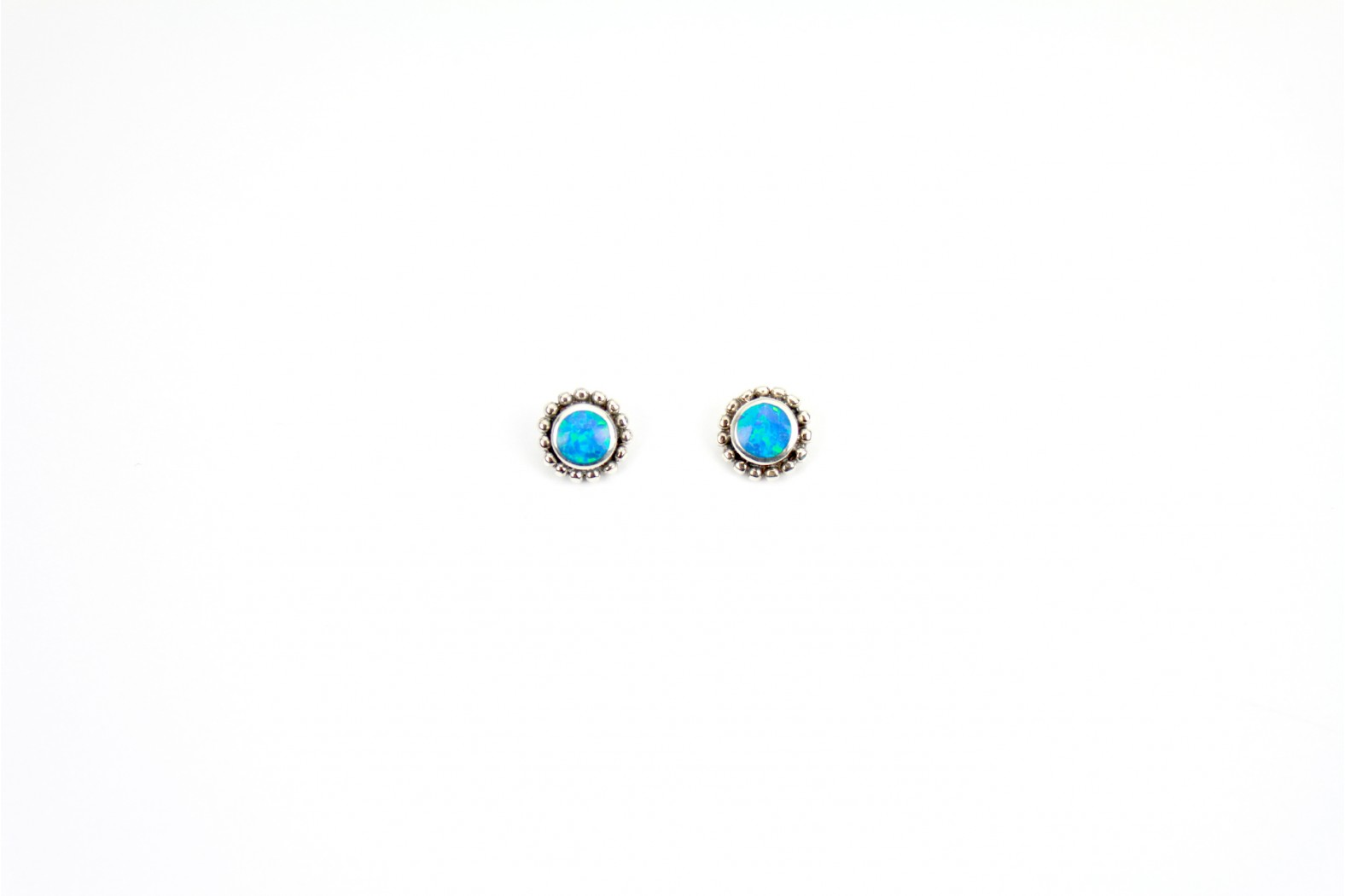 Circular Blue Opal Fire created stud earrings with antique setting