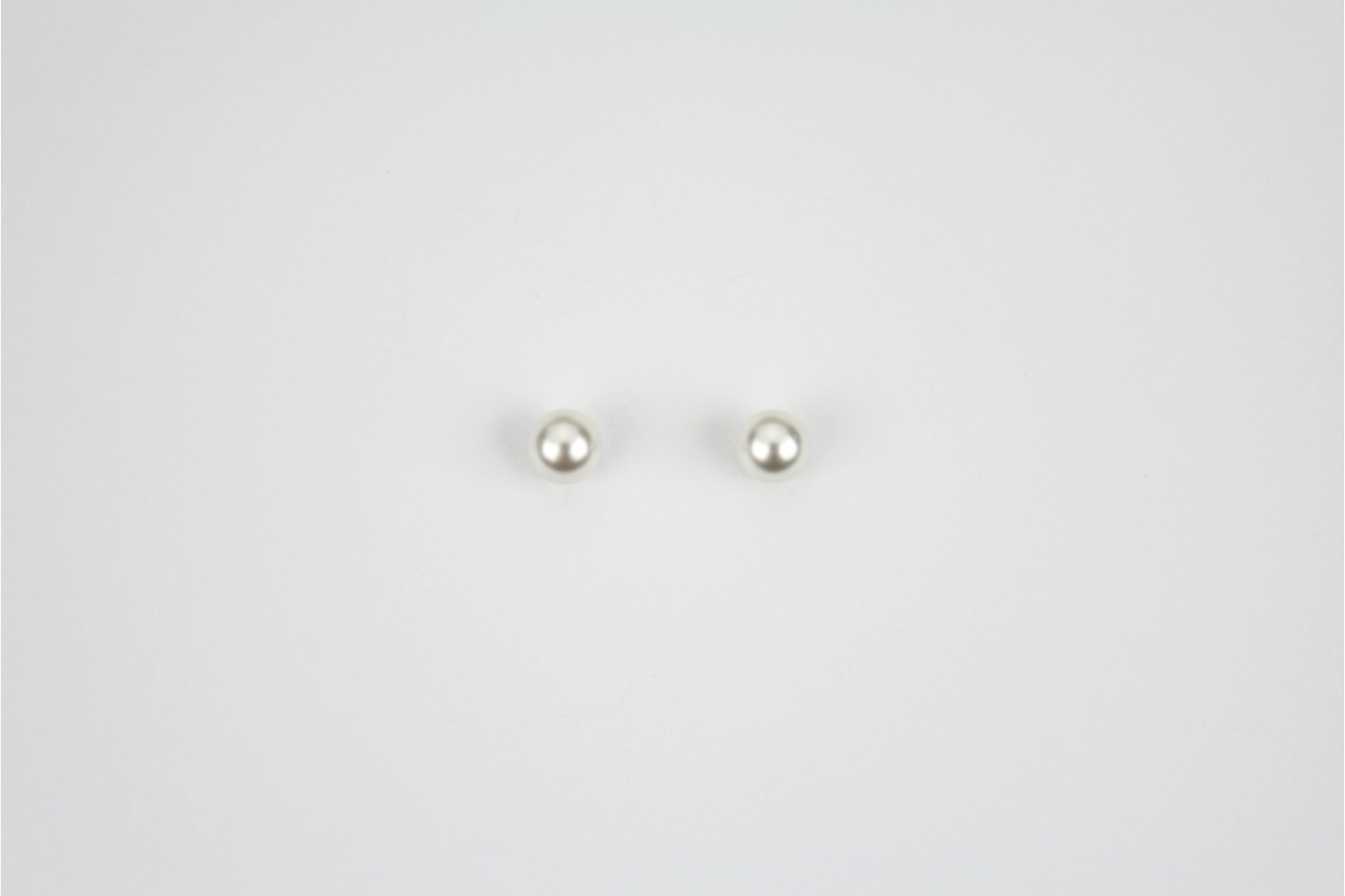 Circular silver colour small ball stud earrings
