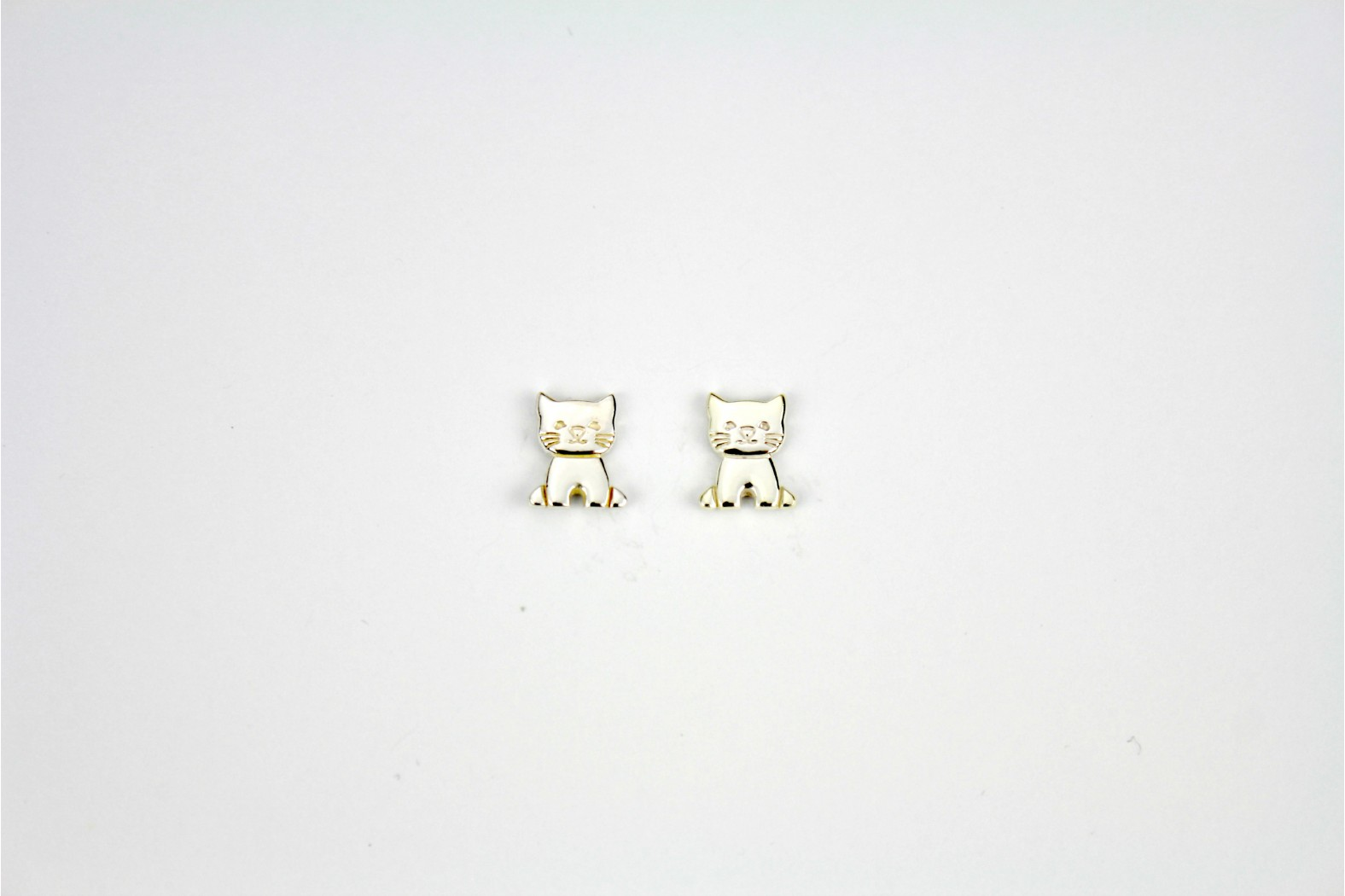 Beautiful Bright Silver front facing cat stud earrings